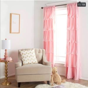 Pink double panel curtains with ruffle detail